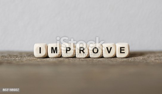 istock Word IMPROVE made with wood building blocks 853188932