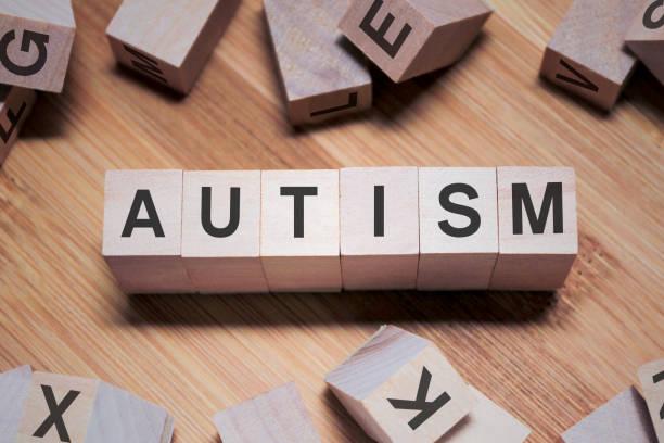 autism word in wooden cube - autismus stock-fotos und bilder