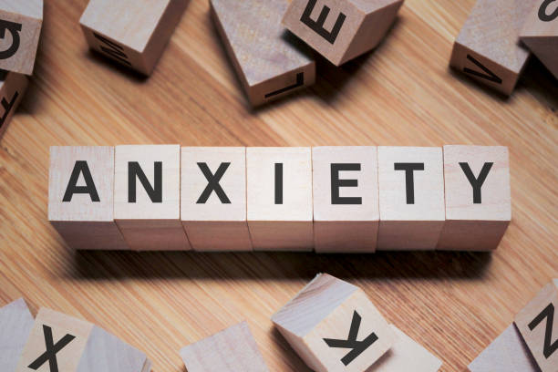 ANXIETY Word In Wooden Cube stock photo