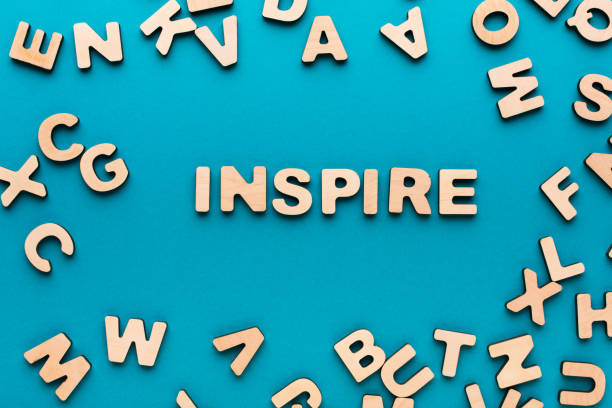word inspire on blue background - word game stock pictures, royalty-free photos & images