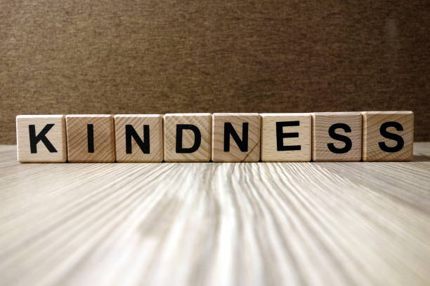 Word kindness from wooden blocks stock photo