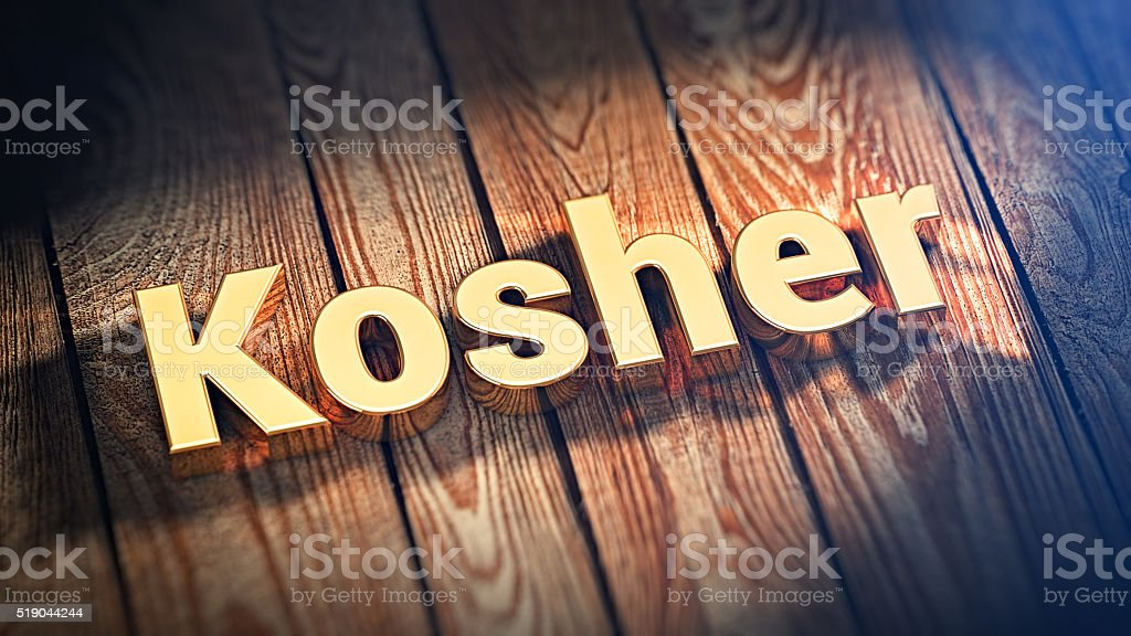 Word Kosher on wood planks stock photo