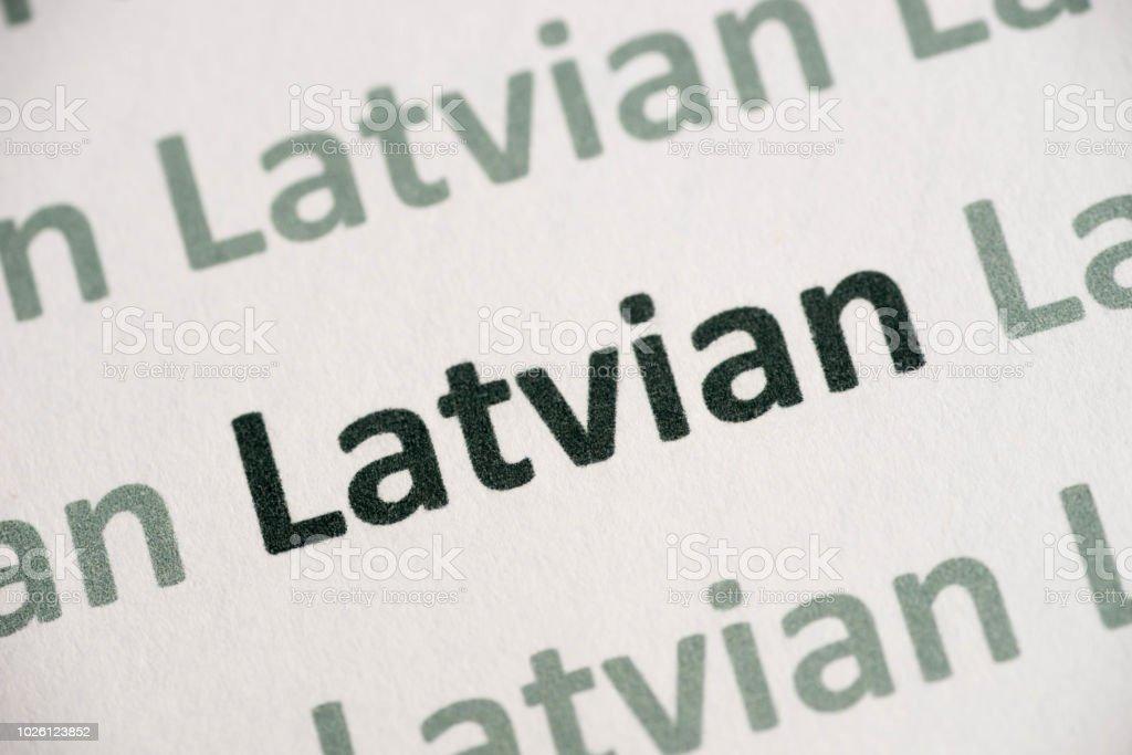 Word Latvian Language Printed On Paper Macro Stock Photo