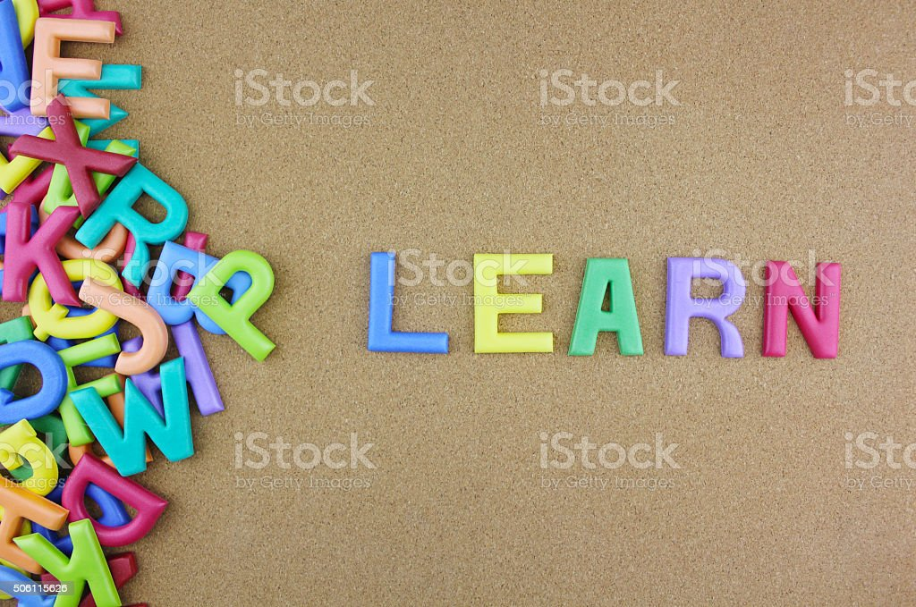 Word 'LEARN' next to a pile of other letters stock photo