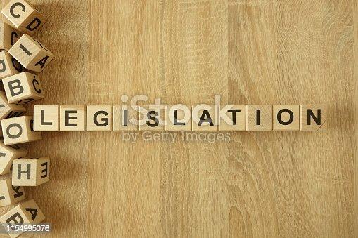 istock Word legislation from wooden blocks on desk 1154995076
