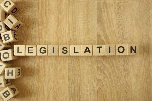 Word legislation from wooden blocks on desk stock photo