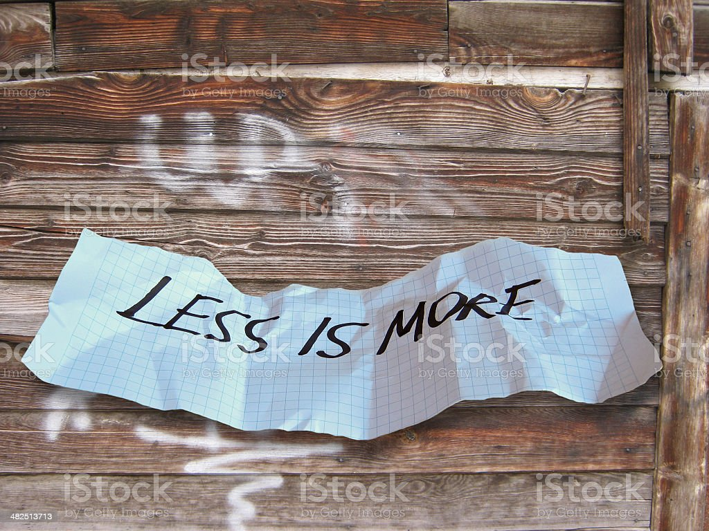 word less is more on torned paper stock photo