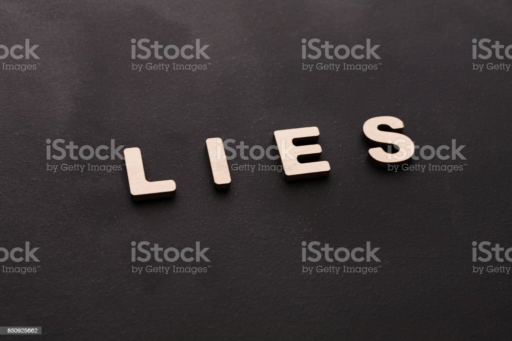 Word Lies on black background stock photo