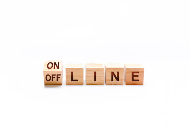 Word LINE next to a spinning cube with the words ON and OFF. Internet concept stock photo