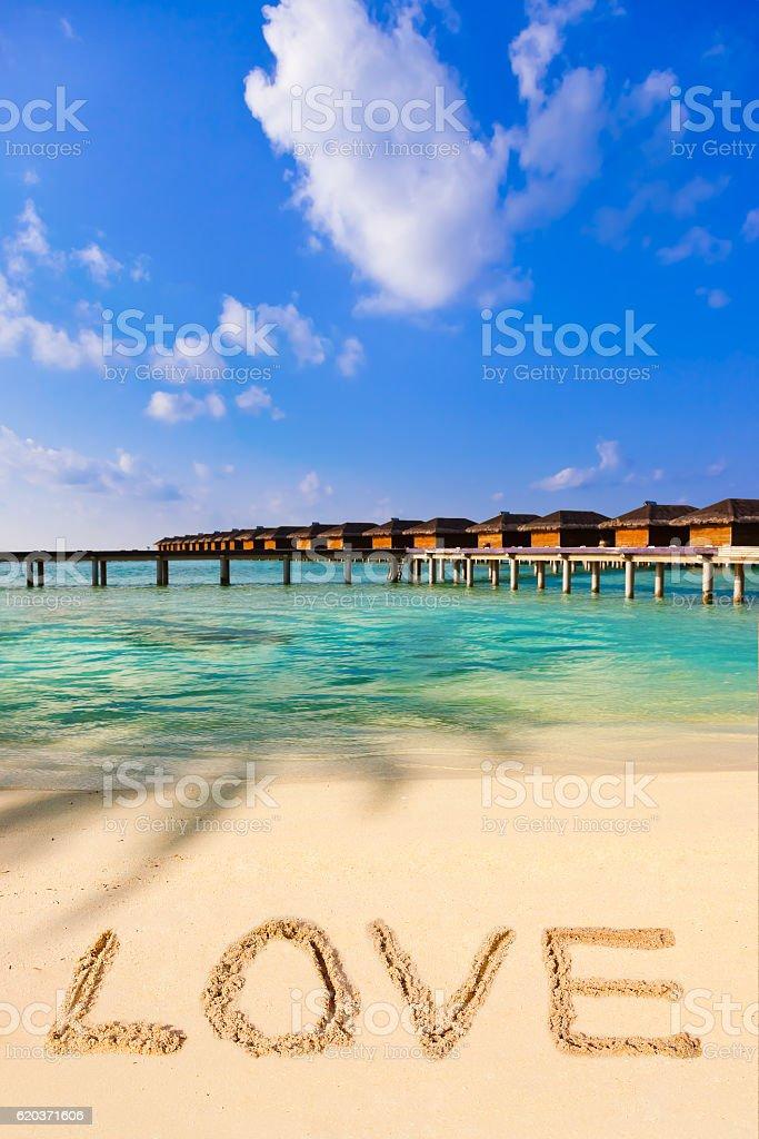 Słowo miłość na plaży zbiór zdjęć royalty-free