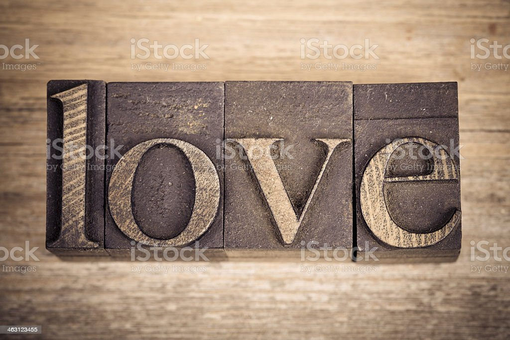 Word love printed in four books stock photo