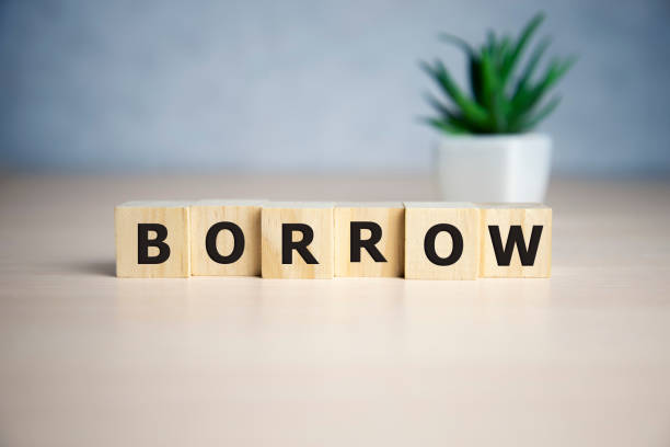 BORROW word made with building blocks. business concept. BORROW word made with building blocks. business concept borrowing stock pictures, royalty-free photos & images