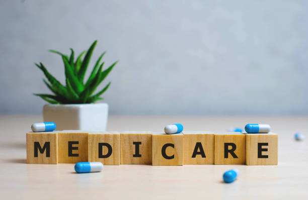 MEDICARE word made with building blocks, medical concept background MEDICARE word made with building blocks, medical concept background. medicare stock pictures, royalty-free photos & images