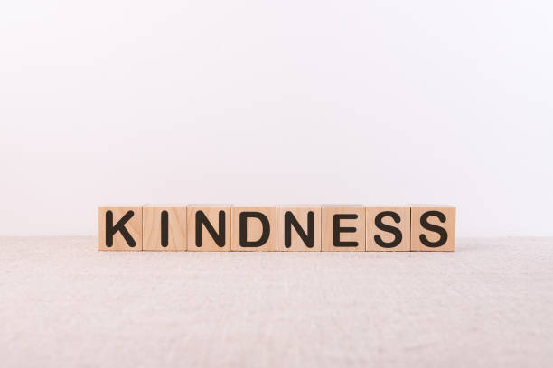 KINDNESS word made with building blocks on a light background stock photo