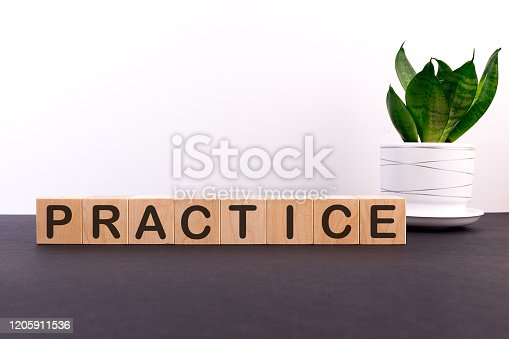 PRACTICE word made with building blocks on a light background