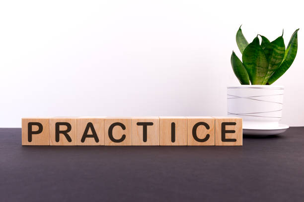 PRACTICE word made with building blocks on a light background PRACTICE word made with building blocks on a light background practicing stock pictures, royalty-free photos & images