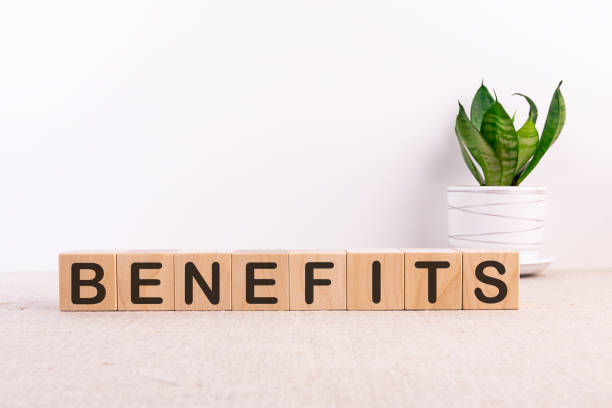 BENEFITS word made with building blocks on a light background stock photo