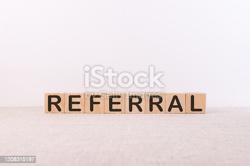 REFERRAL word made with building blocks on a light background