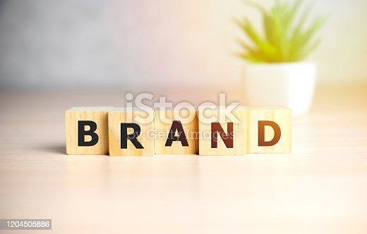 BRAND word made with building blocks on sun shine background