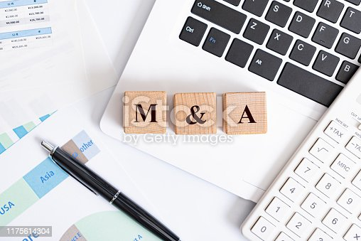 M&A word made with building blocks