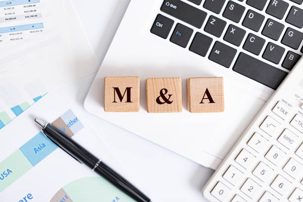 M&A word made with building blocks stock photo