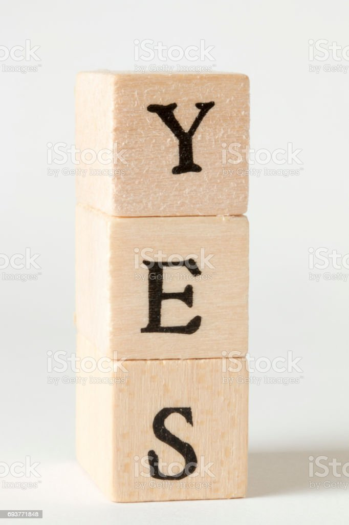 YES word made with building blocks - Sign of acceptance stock photo