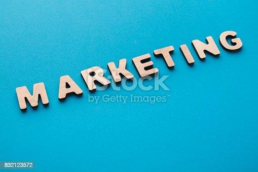 185257431 istock photo Word Marketing on wooden background 832123572