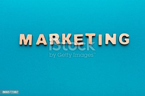 185257431 istock photo Word Marketing on wooden background 866572062