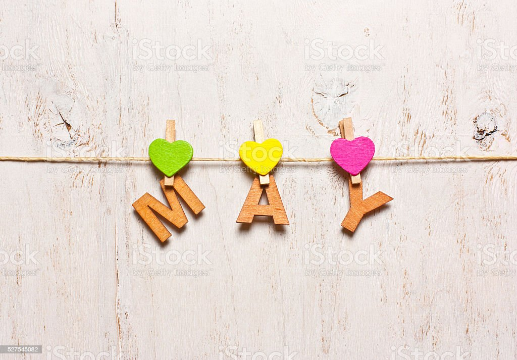 word 'may' from the wooden letters on a white background stock photo