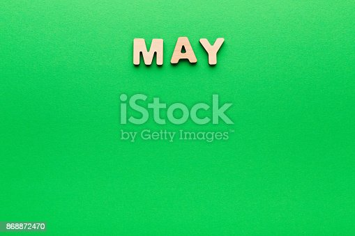 istock Word May on green background 868872470