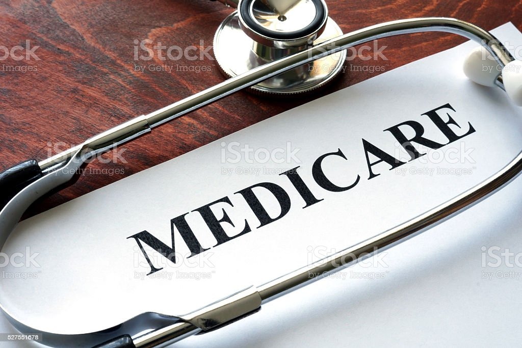 Word medicare written on a paper and stethoscope. stock photo