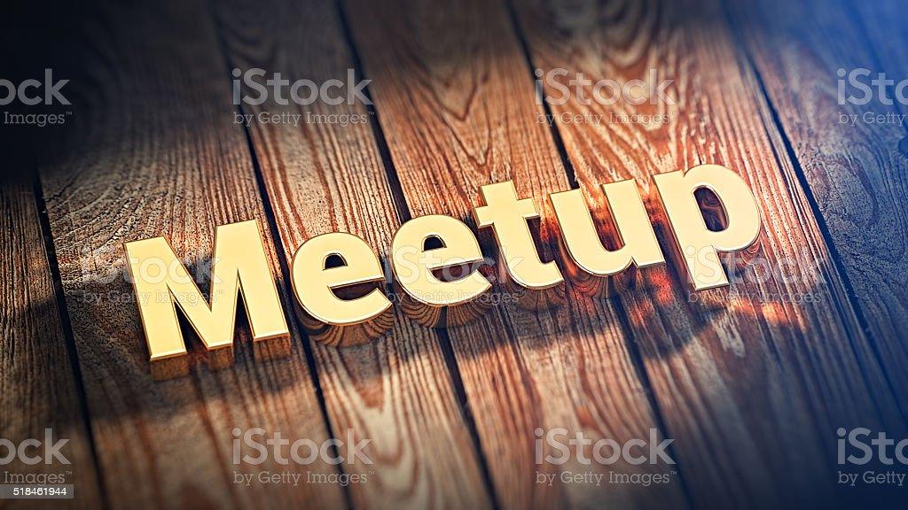 Word Meetup on wood planks stock photo