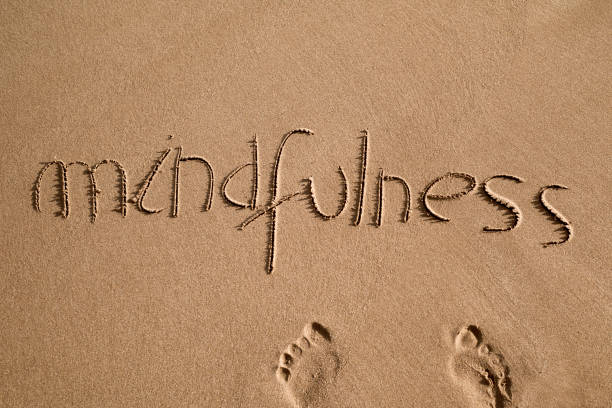 word mindfulness in the sand - mindfulness stock photos and pictures