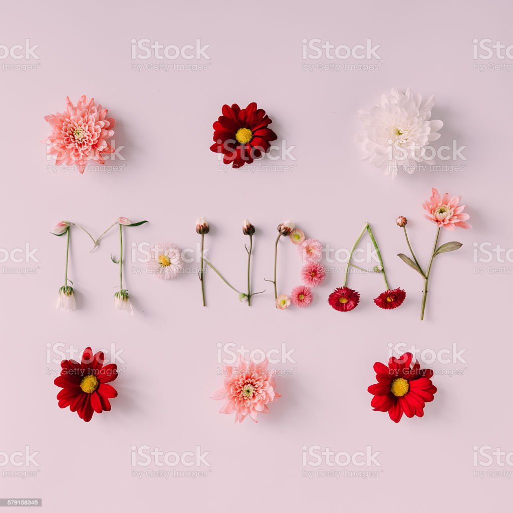 Word 'MONDAY' made of flowers on bright background stock photo