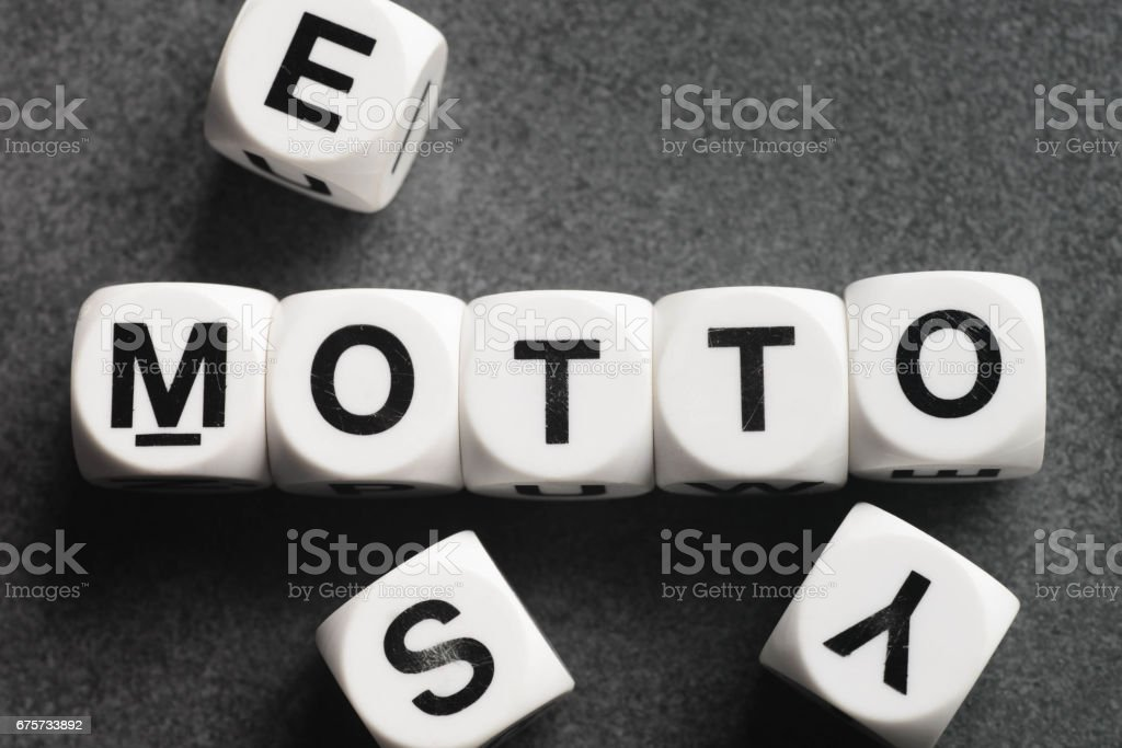 word motto on toy cubes stock photo
