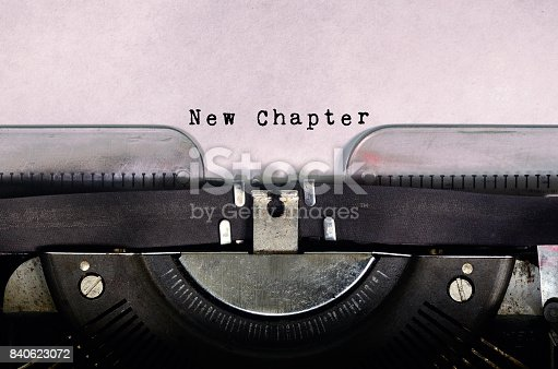istock Word New Chapter Typed on Vintage Typewriter 840623072