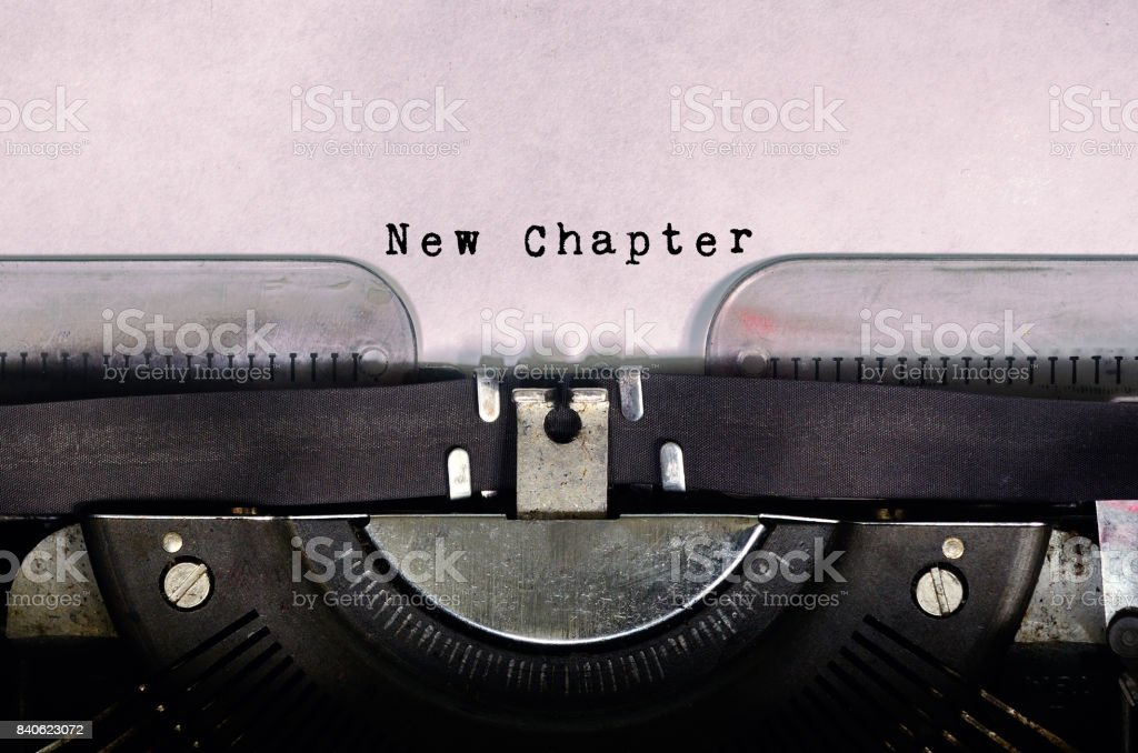 Word New Chapter Typed on Vintage Typewriter stock photo