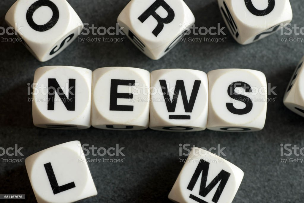 word news on toy cubes royalty-free stock photo