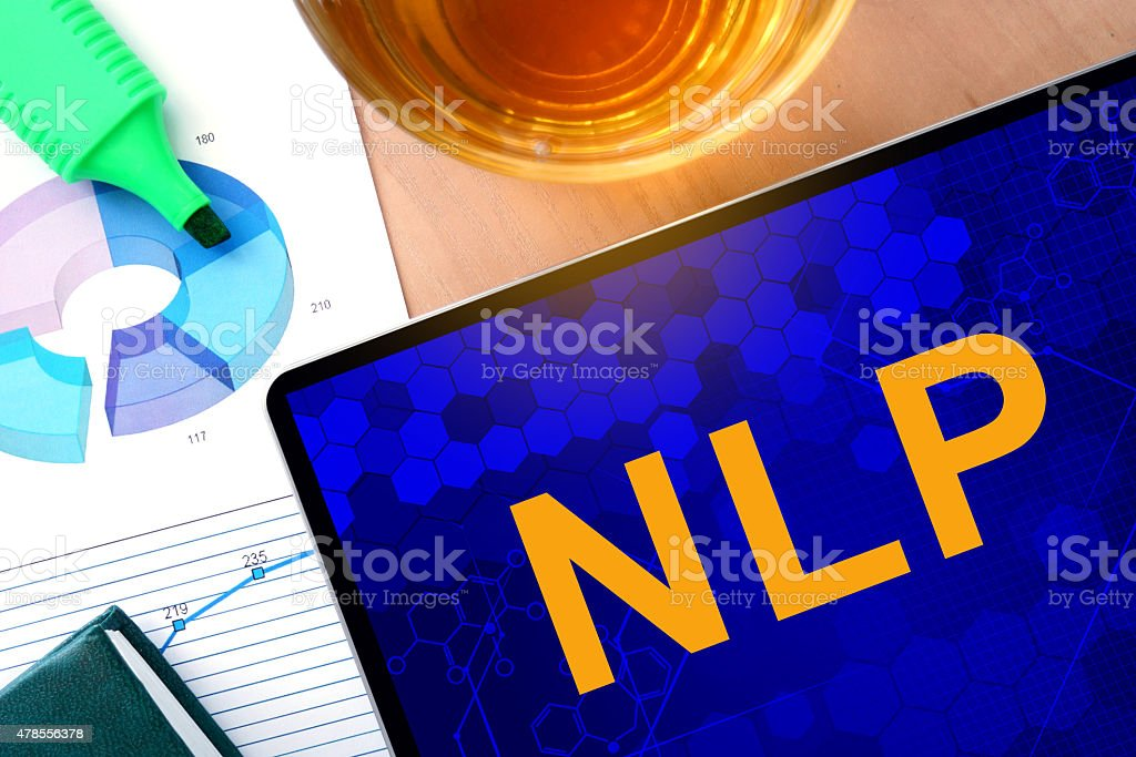 Word NLP  on the tablet and charts. stock photo