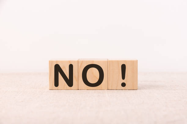 Word NO is written on wooden blocks on a light background. Word NO is written on wooden blocks on a light background. single word no stock pictures, royalty-free photos & images