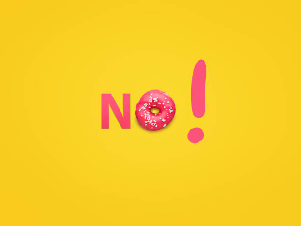 Word No with exclamatory sign Orange background with pink glazed doughnut and pink letter arranging word No with exclamation. temptation stock pictures, royalty-free photos & images