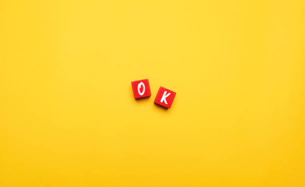 word ok on yellow background - word game stock pictures, royalty-free photos & images