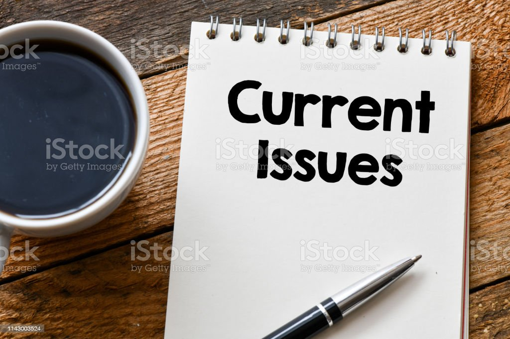 CURRENT ISSUES word on a wooden background. current issues concept stock photo