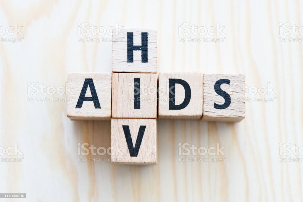 AIDS/HIV word on a wooden table .Aids / HIV Concept stock photo