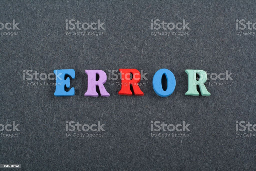 ERROR word on black board background composed from colorful abc alphabet block wooden letters, copy space for ad text. Learning english concept stock photo