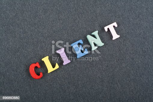 istock CLIENT word on black board background composed from colorful abc alphabet block wooden letters, copy space for ad text. Learning english concept 696860680