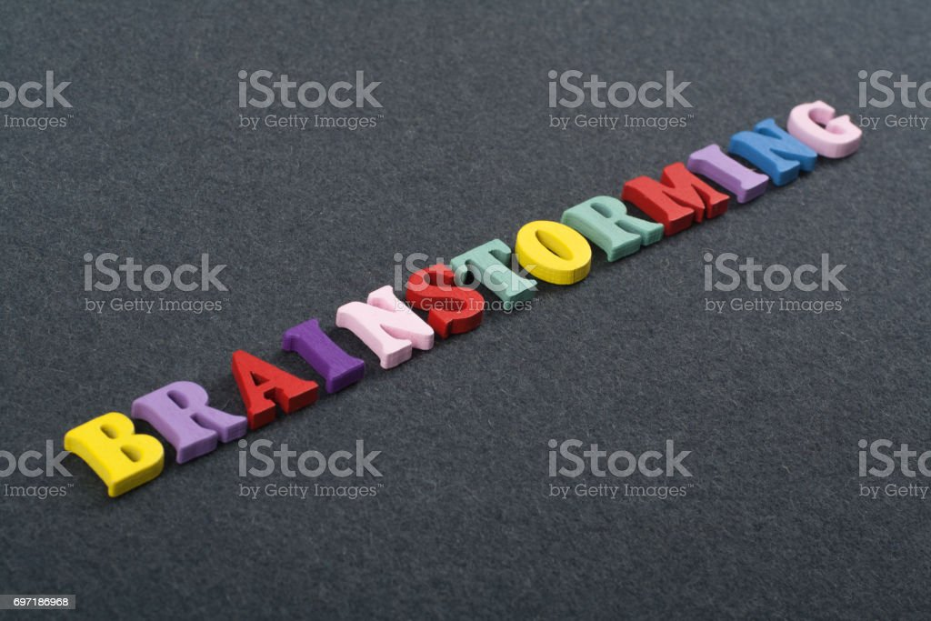 BRAINSTORMING word on black board background composed from colorful abc alphabet block wooden letters, copy space for ad text. Learning english concept stock photo