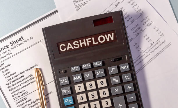 CASHFLOW word on calculator and pen on documents CASHFLOW word on calculator and pen on documents cash flow stock pictures, royalty-free photos & images