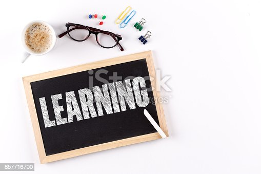 850892616 istock photo LEARNING word on Chalkboard with Coffee Cup, view from above 857716700