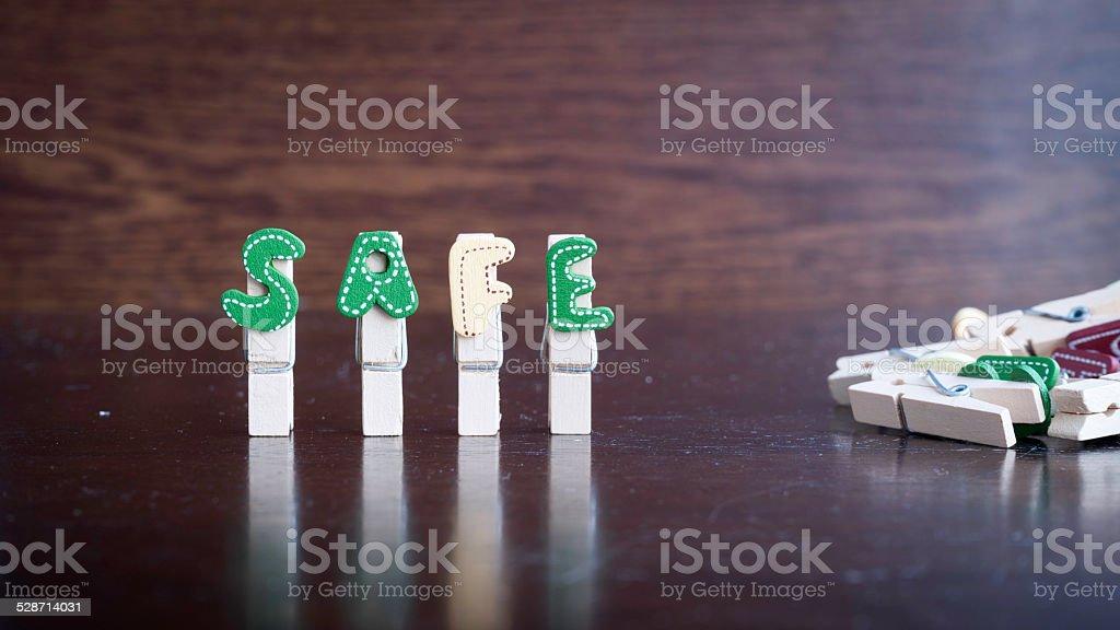 SAFE word on clothes peg stick stock photo
